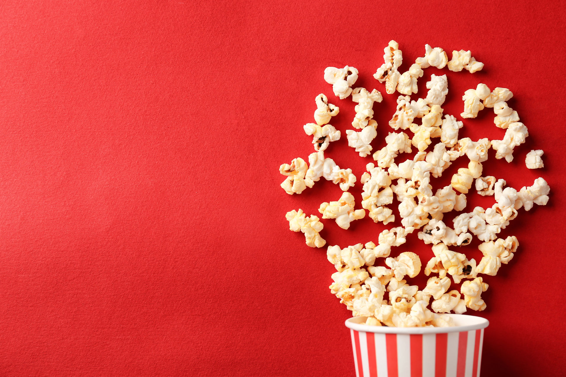 red background with bucket of popcorn