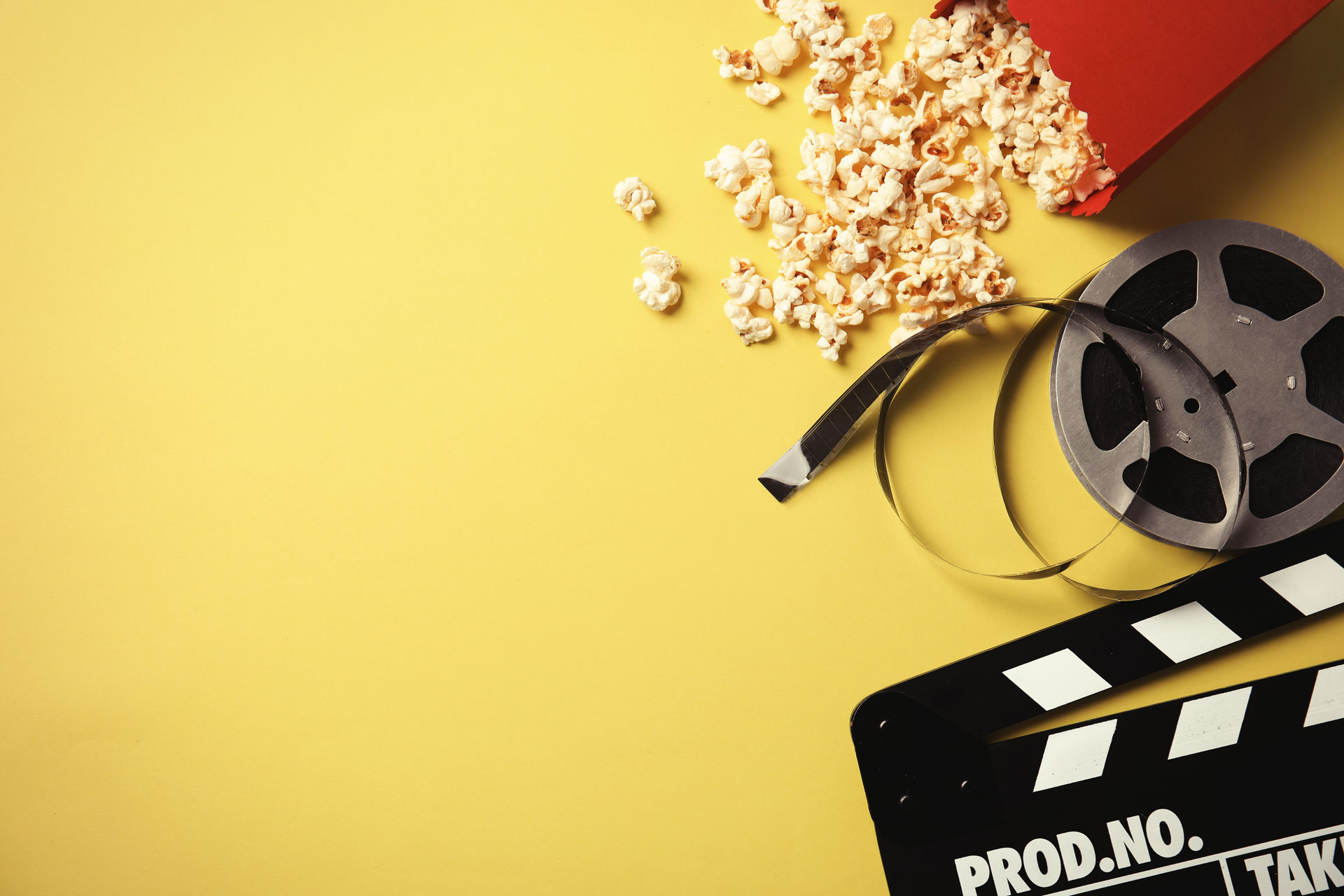 yellow background with bucket of popcorn